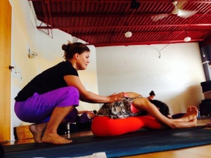 Dr. Ochester assisting yoga